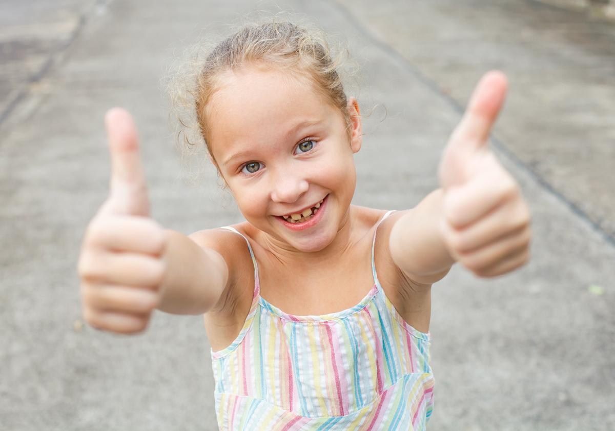 happy-girl-shows-gesture-cool-XKCDM69.jpg