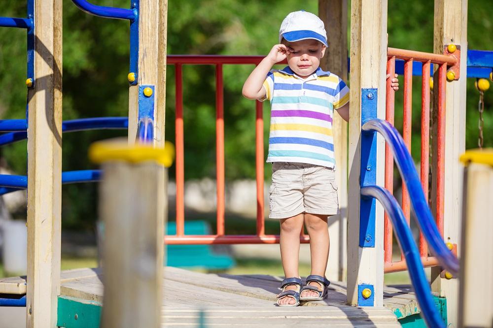 little-boy-crying-on-playground-PYK2LDB.jpg
